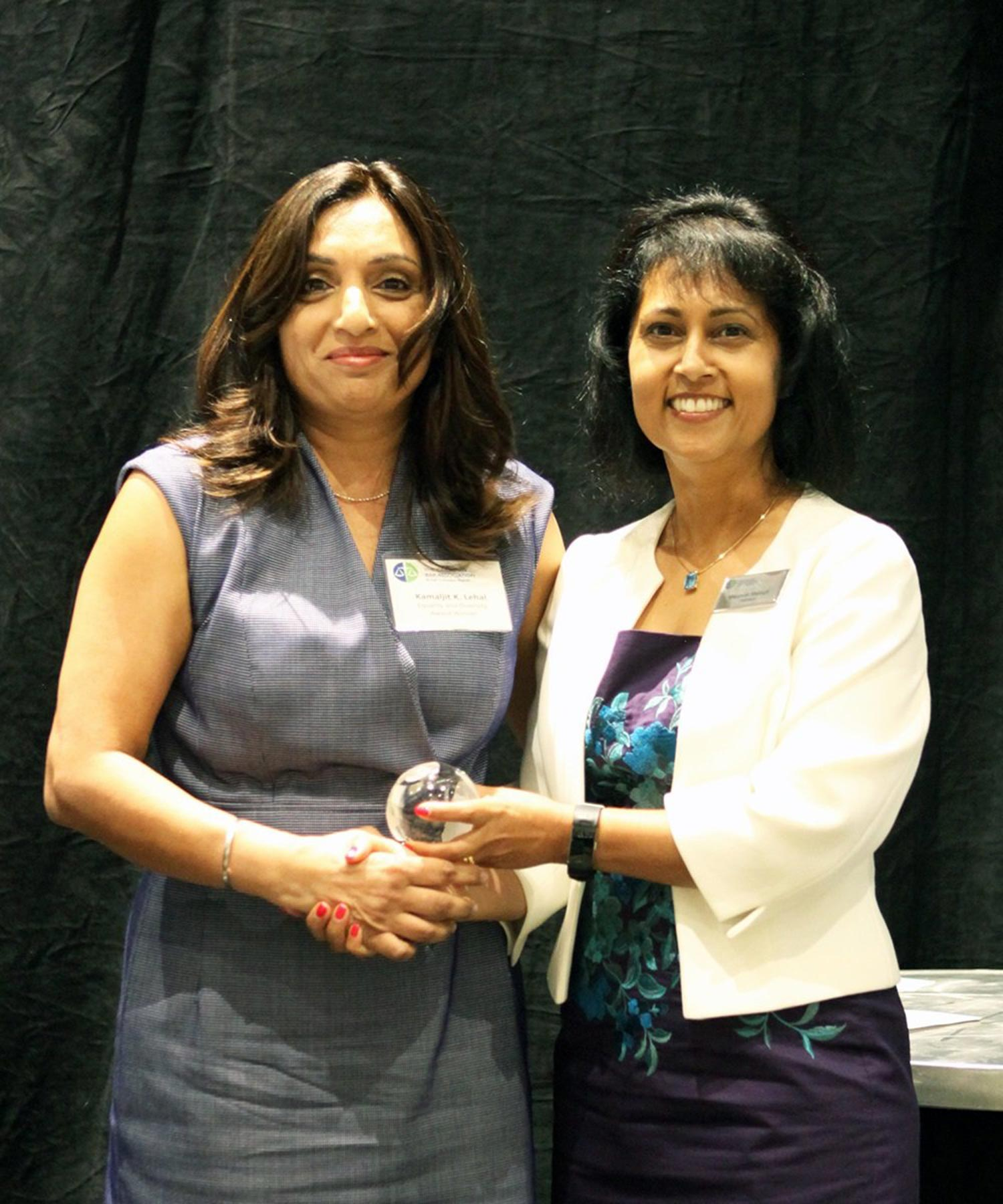 Kamaljit Lehal receiving the CBA Equality Award (with Margaret A. Mereigh)